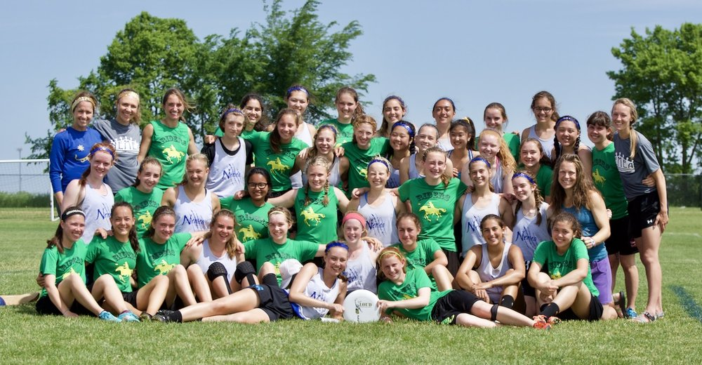Kelly Donovan Commemoration. Sportscore Two. Loves Park, Illinois. June 2017. Roosevelt (Rough Riders) and Madison West (Nemea) Girls Ultimate Teams pose with a Kelly Donovan Award disc to commemorate Kelly's connections to Madison and Seattle. The teams played one another at the inaugural High School National Invite ultimate tournament. © William D. Walker