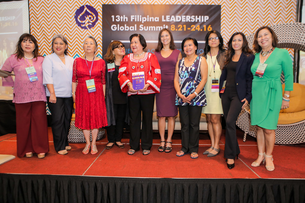Former Governor of Antique Sally Zaldivar Perez (center, in red) photographed with (L-R): Bing Carrion (Global FWN100™ '16), FWN Board Members Nini Alvero (Global FWN100™ '16), Maria Beebe, FWN Founder & CEO Marily Mondejar, FWN President Susie Quesada, FWN Board Member Thelma Boac, Jopin Romero (Global FWN100™ '16), Rosario Cajucom-Bradbury (Global FWN100™ '16), Evelia Religioso (Global FWN100™ '13)