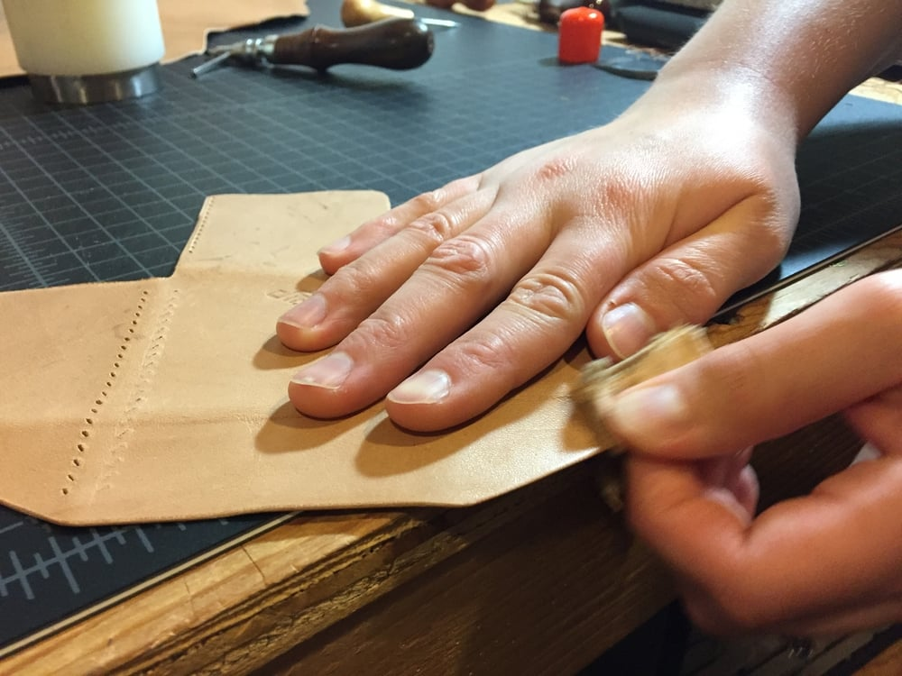 Burnishing the edges. This leather burnishes really well.