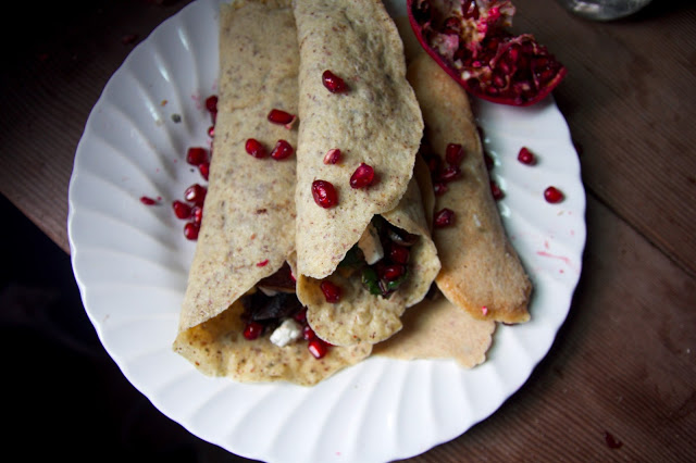 Almond Flour crepes with wilted chard, leek, goat, apple, and goat Cheese