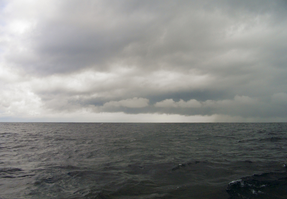 Small squalls such as this were a welcome site during the crossing because they meant stable boat speed and easy sailing as compared to the wobbly light and variable bouncing and rolling they experienced for most of the crossing.