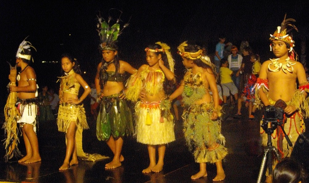 A dance group prepares to perform at the Tapa Tapa competition. Marquesan children from different islands come together to be judged on how well they sing, dance, and recite legends.