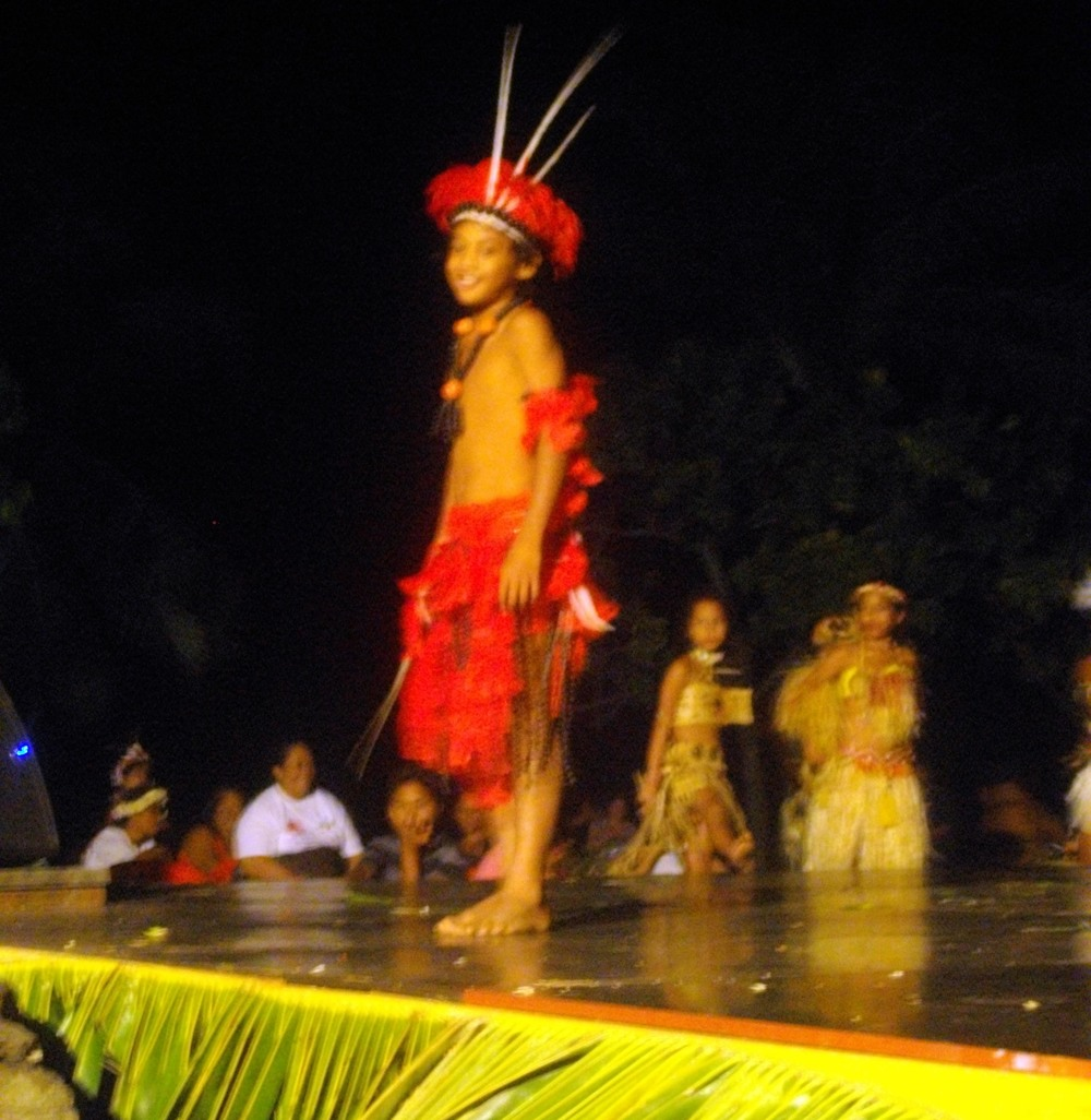A Marquesan boy performs a traditional dance.