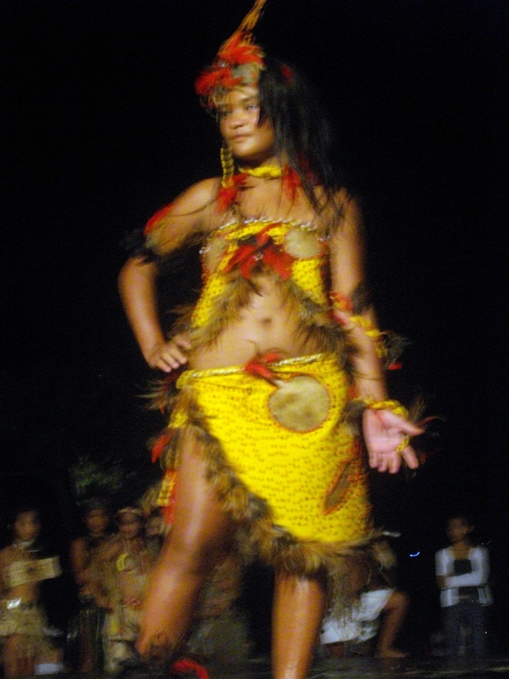 A Marquesan girl performs a traditional dance.