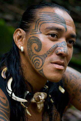 "Unlike today, Marquesan tattoos were never a symbol of individuality. Quite the opposite. Not only were they obligatory, the person being tattooed did not have much of a say on what was written on their person. Tattoos were intended to convey tribe identity, social status, rank, family, and identity otherwise imparted to that person by the gods and their community, as written onto them by the priest. A tween girl would receive her first tattoo after a week of isolation in a hut, away from the community, upon her first menses. The boys were usually tattooed between the ages of 13 and 15, depending on when the chief's son received his. The boys would then be marked in the chief's son's honor, which culminated in a bare naked dance by the chief's son for the rest of the tribe. The ""old-fashion"" way was ""jail-style,"" as the artist impelled pigment by tiny individual pigment into the skin, the ink made from berries. Eventually, men were covered from head to toe in tattoos. Coconut oil infused with ginger was used to make the tattoos shine during dance and to prevent infection. The more tattoos you had, the more important you were! (Photo credit: Polynesian Maori Tattoo)"