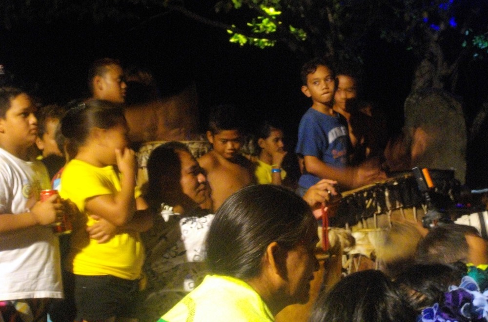 As the children perform, they are accompanied on multiple style drums by other kids of varying ages, all led by an adult. And boy do these kids got rhythm!!