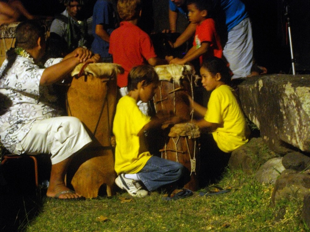 Marquesan children practice their drumming.