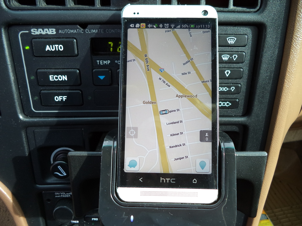 Phone cradle installation with factory head unit retained, audio input and hands-free calling.