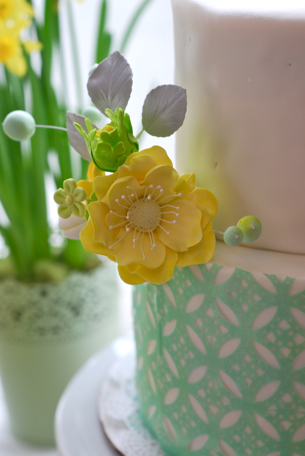 Handmade sugar flowers.  Yellow anemone flower and bud.