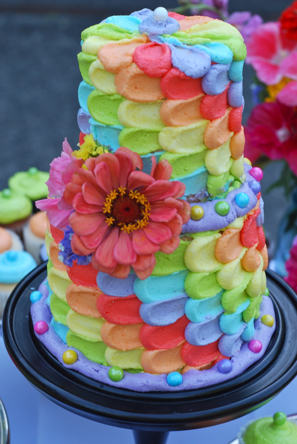 Two-tier vanilla buttercream rainbow cake