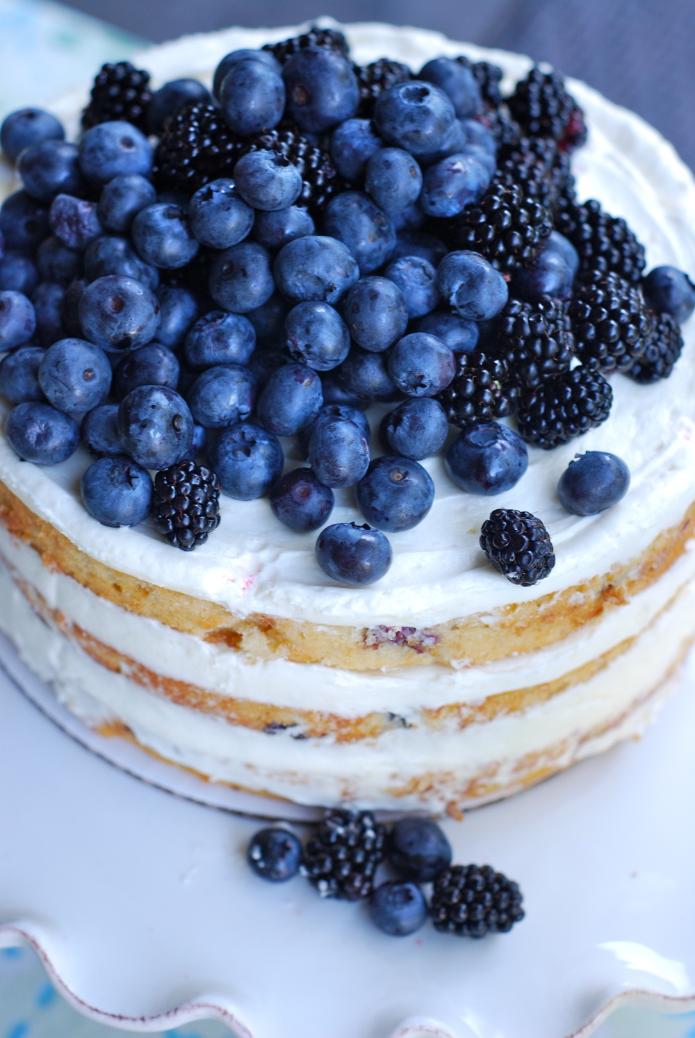 Lemon naked cake with blueberries and blackberries