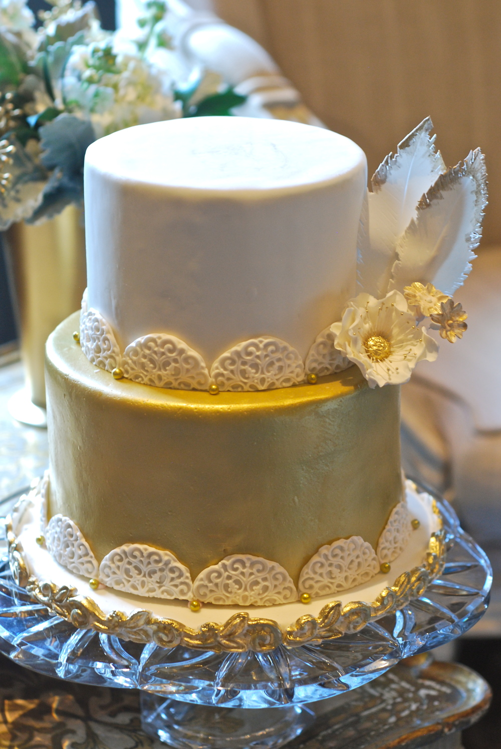 Two-teired German chocolate and carrot cake, decorated with gilded sugar anemone & feathers.