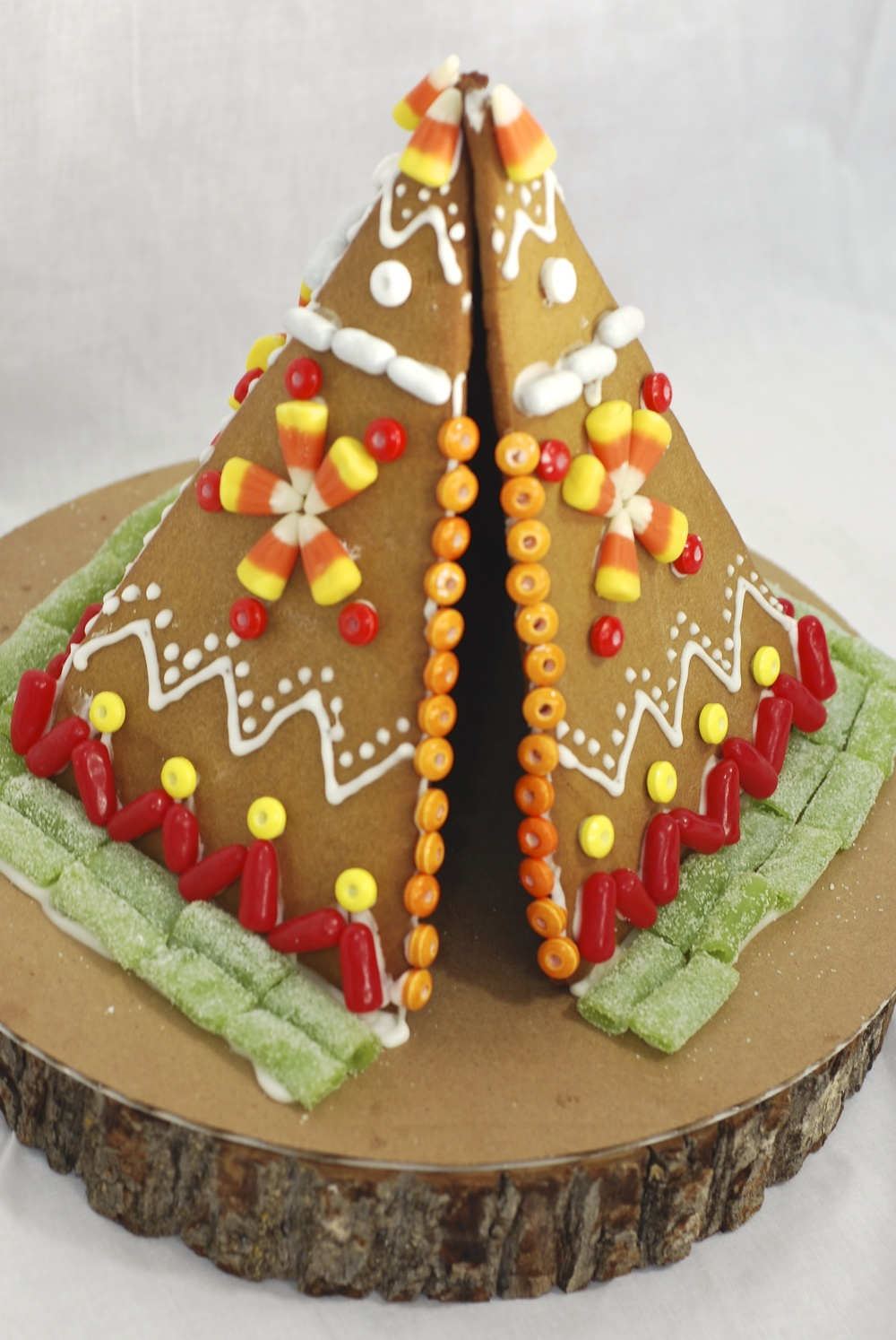 A little something to keep the kids entertained….a gingerbread teepee!  The granddaughters had a blast decorating this one with us yesterday;)