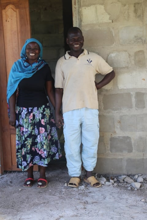 Esther and her husband stand outside their home. Credit: Abena Agyeman-Fisher