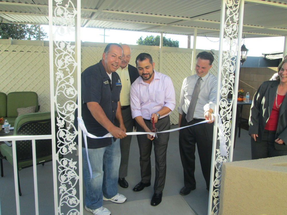 Mayor Marcel Rodarte cuts the ribbon. Also pictured (left to right) are Vice Mayor Leonard Shyrock, President of HOPE's board Bob Irlen, Executive Director of HOPE Kristin Martin and Norwalk Housing Manager Kristin Maithonis.