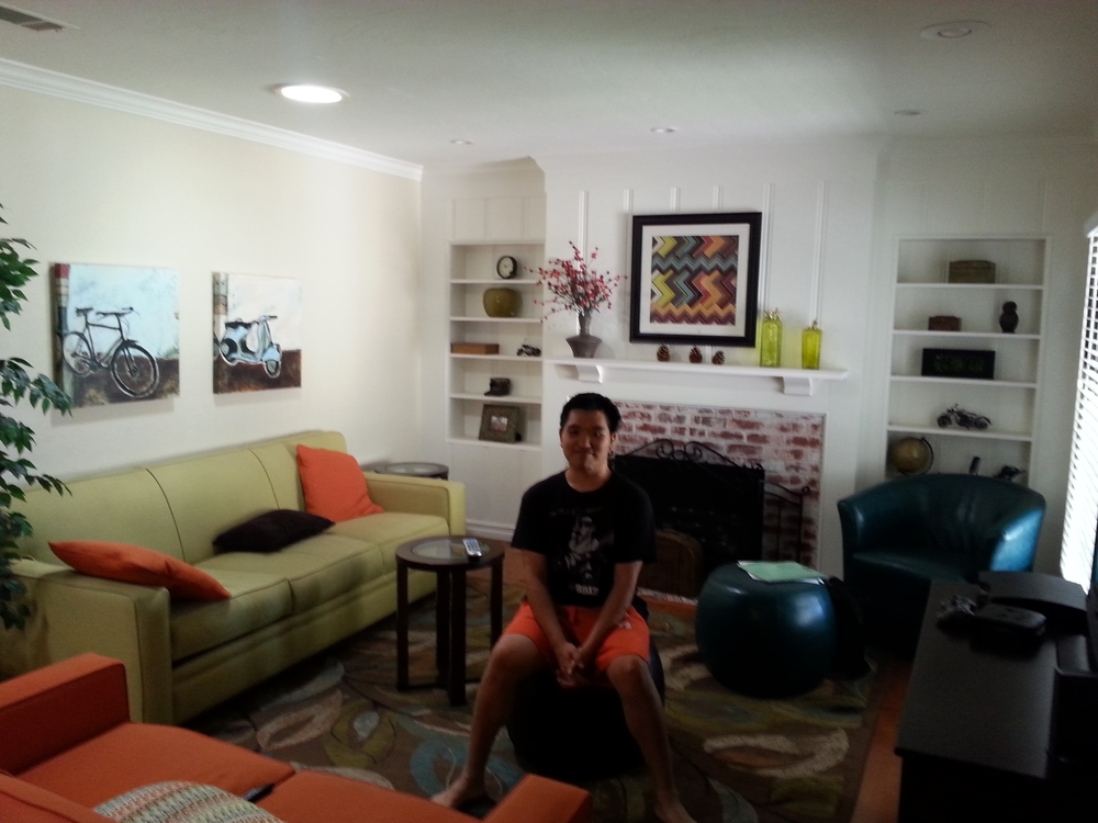 A college to career student enjoying the living room in his C2C HOPE home.