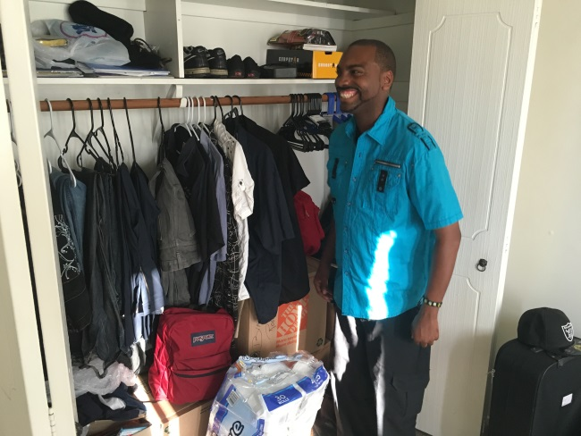 Brandon unpacking his belongings at his new HOPE home in Long Beach.