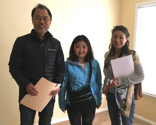 Newest HOPE resident Hazuki Kobayashi (center) with parents as she moves into her first apartment at Banner.