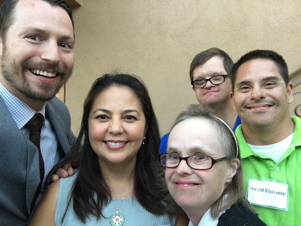 HOPE staff Ian Nevarez, HRC staff Vivian Galaviz, and new residents Jody, Thomas and David.