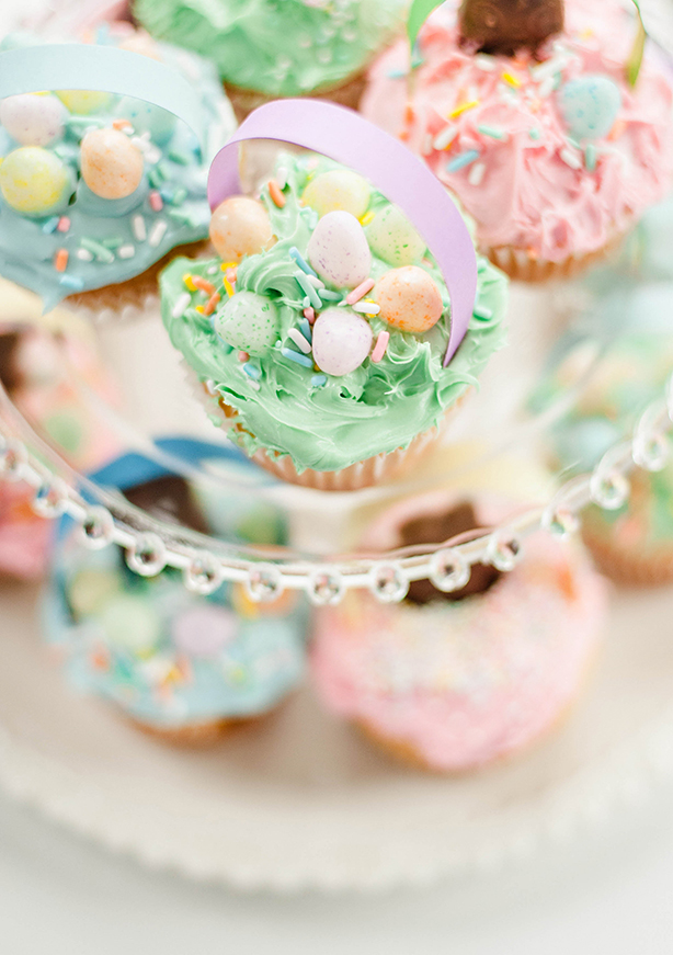 I got inspiration from topinspired.com for these scrumptious cupcakes HERE! We used funfetti mix and food coloring in our vanilla frosting. To top them, we used speckled jelly beans, chocolate bunnies, sprinkles, and strips of color card stock for the handles. They're much simpler than they look, I promise! : )