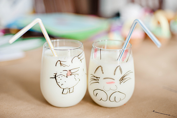 You'll need some milk while you're making those cupcakes! The kids drew bunny faces on their milk glasses with whiteboard markers. : )