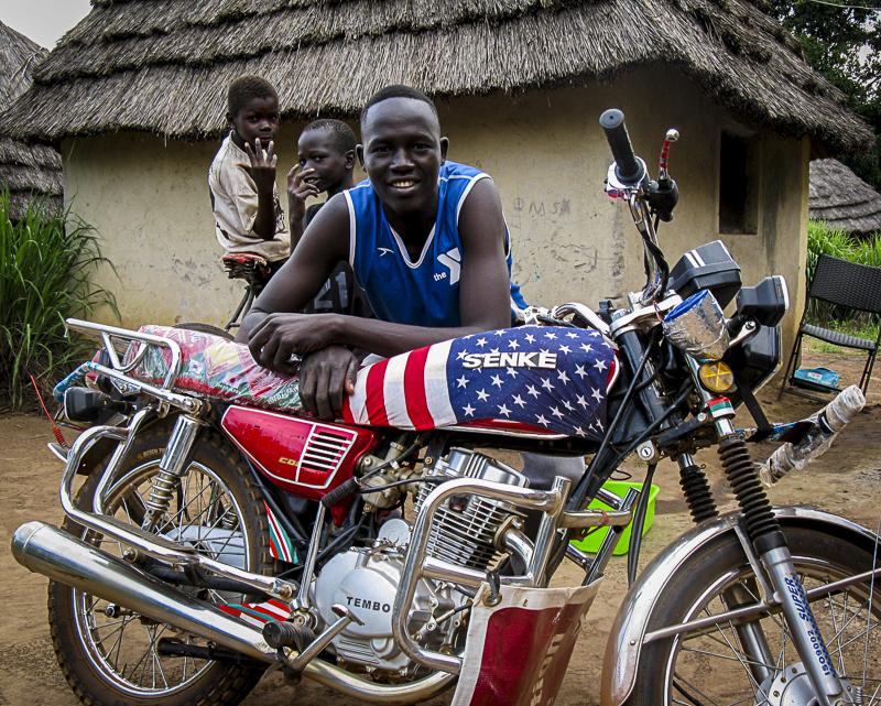 Kaya with his favorite thing, his motorcycle
