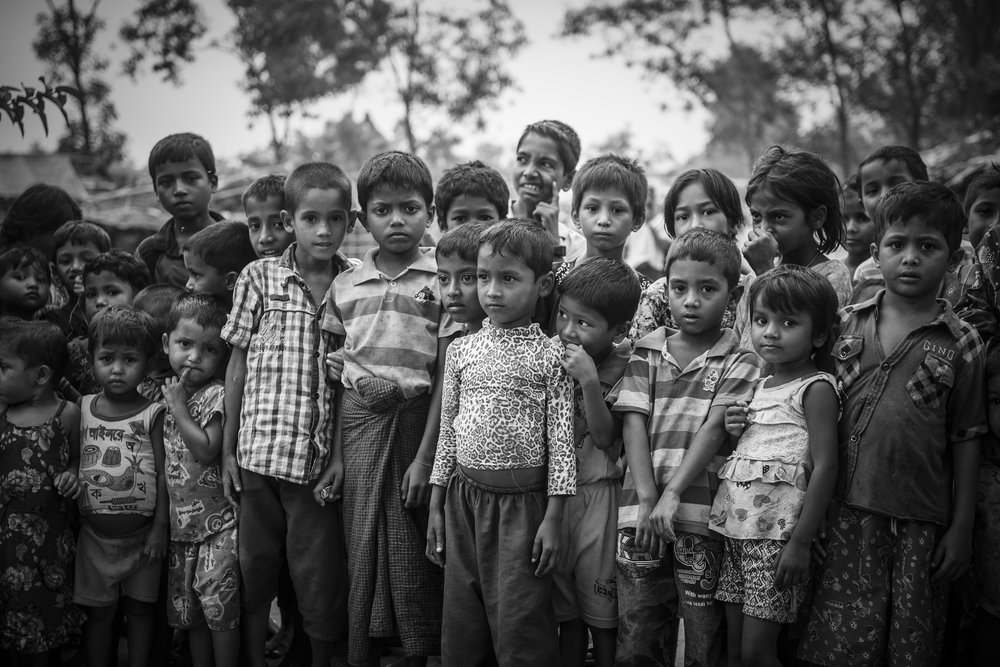 When walking through Kutupalong refugee camp, the number of kids following me grew so large that for a while it became difficult to get a picture that didn't include several kids looking into the lens. And so we stopped for an organized group picture.