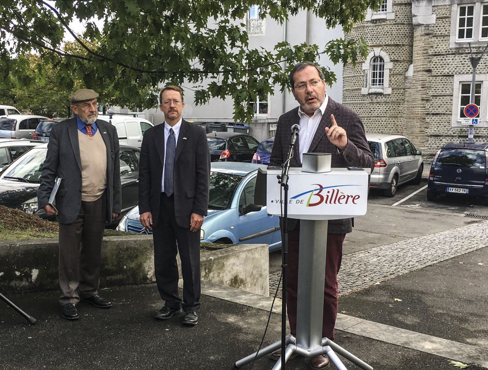 Jean-Yves Lalanne, mayor of Billère, introduces the planting ceremony while Bernard Dalisson, president of Les Pacaniers de Jefferson, and American Consul Daniel Hall await.