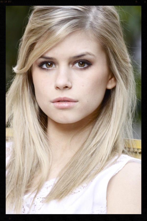 Quinn Valentine played by Carlson Young