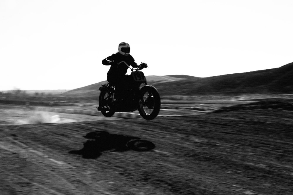Grant Peterson, Vard mfg. Factory rider, launches his 1937 UL at last months Hell on Wheels Stadium Steeplechase.
