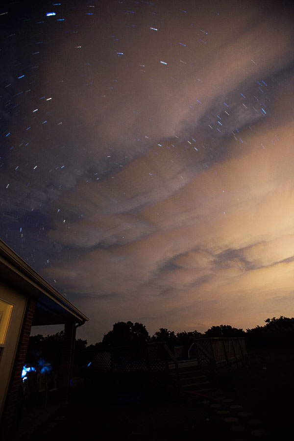 Stars trail around the North Star somewhere behind the fast moving clouds. Photo taken while moon was beginning it's eclipse sometime between 8 and 9:30 PM CST on September 27, 2015