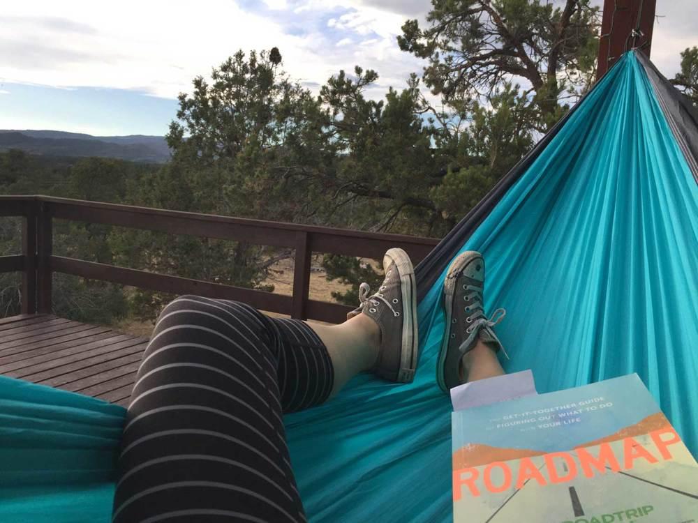 """Reading """"Roadmap"""" in my Trek Light Gear hammock, overlooking the mountains outside of Durango, CO."""