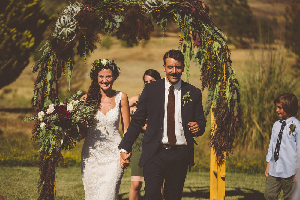 Wife and husband! Ps. Behind the scenes: Kendra's brother built the wooden arch which I adorned with plants and foliage | The Cana Family