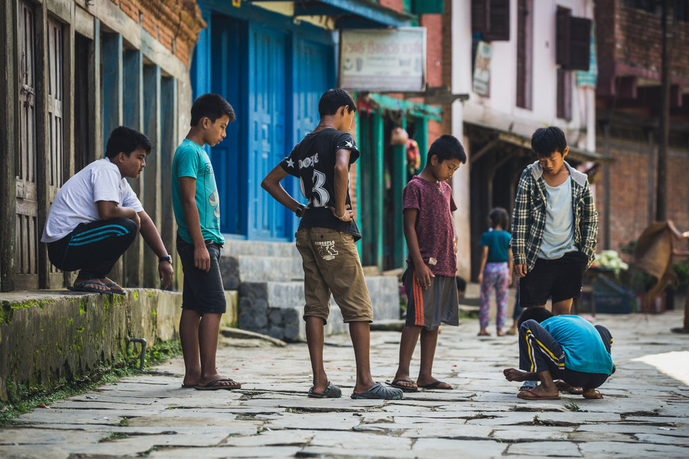 Children play freely along the small streets of Bandipur.  130mm f4.0 1/1250 ISO800