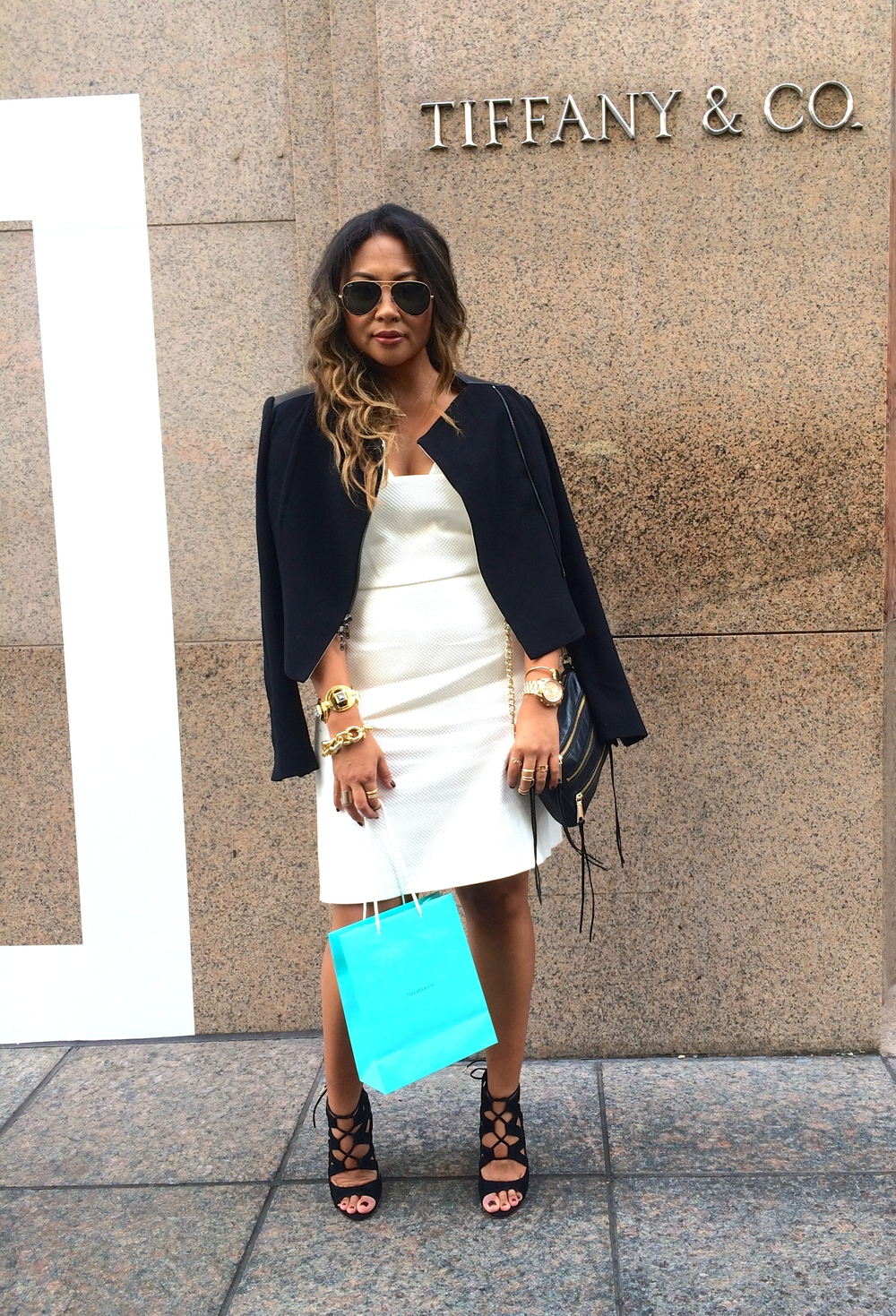 "WHITE + BLACK   ""White with Black"" is a personal favorite combo.  Done the right way, it can make a statement while being the perfect chic look for a power work day.  Adding personal gold touches on your arm stack or ring party is an easy way to add a layer of personal style.  __________________________________________________________  Dress + Jacket :   Rachel Roy   Bag:   Rebecca Minkoff   Shoes:   Dolce Vita   Specs:  Raybans   Bracelets:   J. Crew   Watch:   Micheal Kors"
