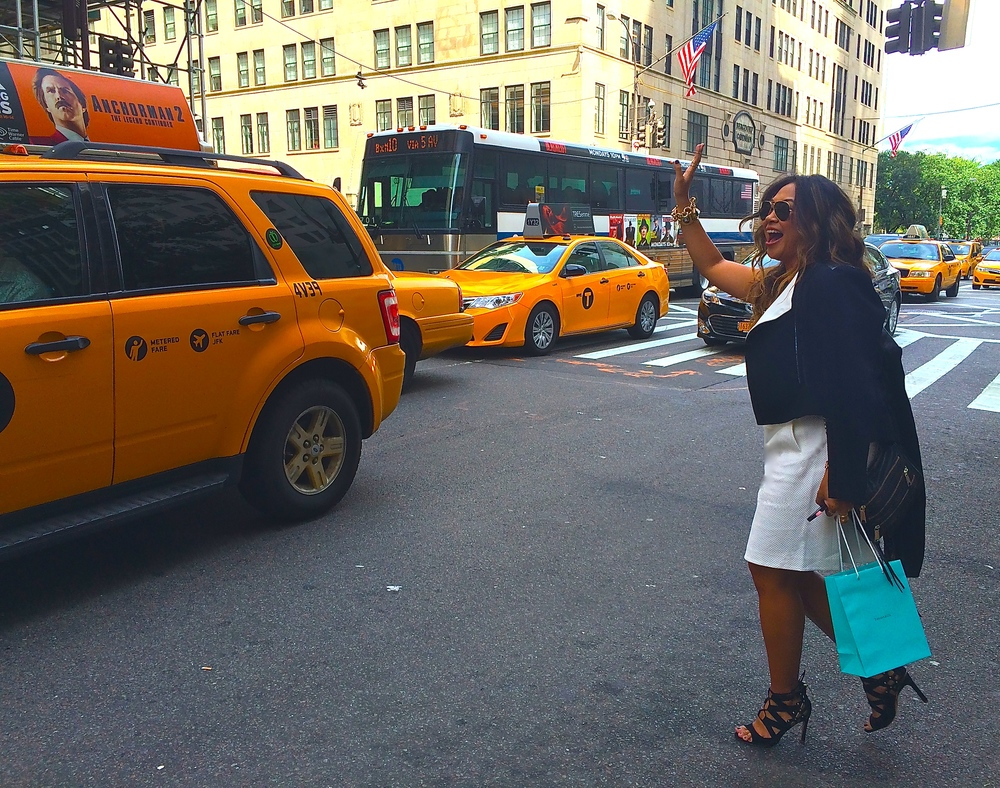 Living my Carrie Bradshaw moment of hailing down the first yellow cab and dashing off to my next meeting.