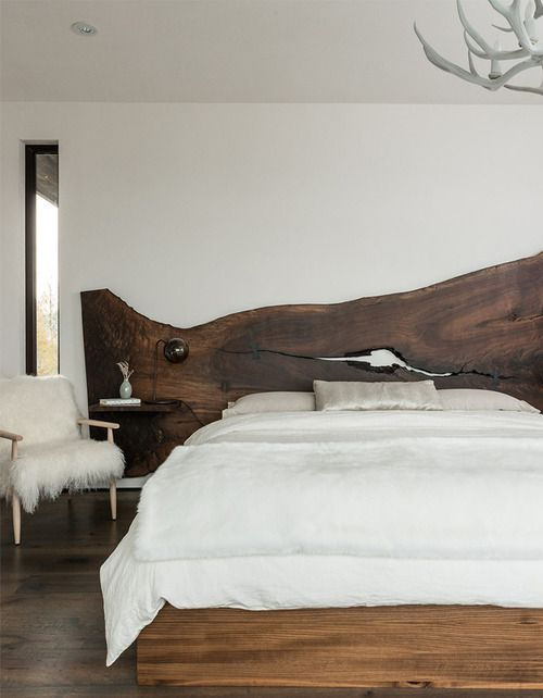 The timber feature bed frame gives the space a rustic, relaxed feel.