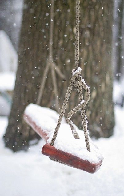 A snow covered swing. Beautiful