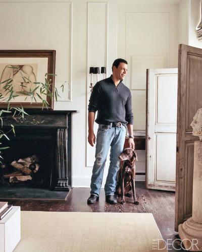 Interior Designer Darryl Carter with his dog Otis.