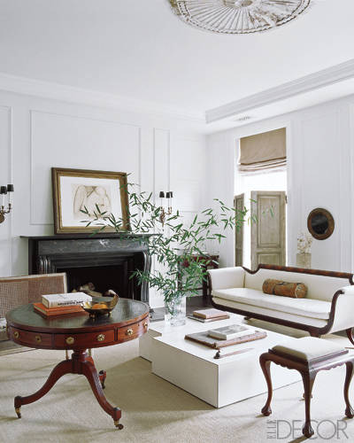 This elegant space features reclaimed belgian shutters and a circa-1920's sofa.