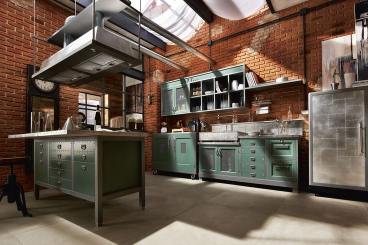 Exposed brick & Green Cabinetry.