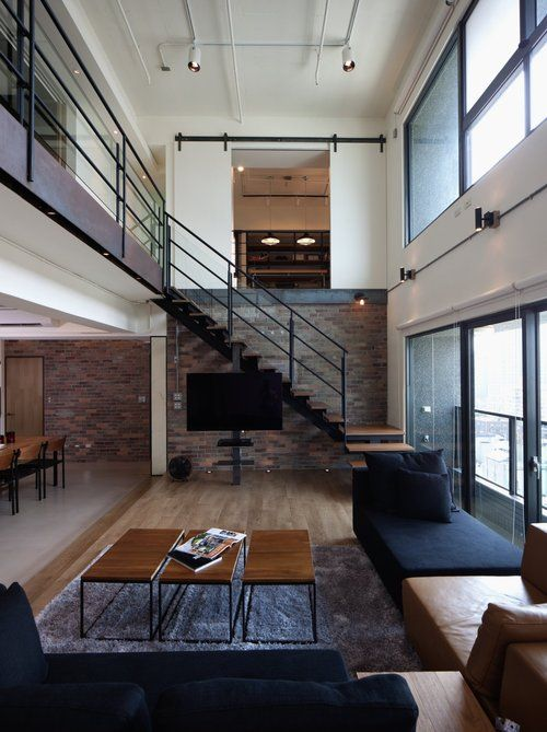 Love this Staircase and the three coffee tables.