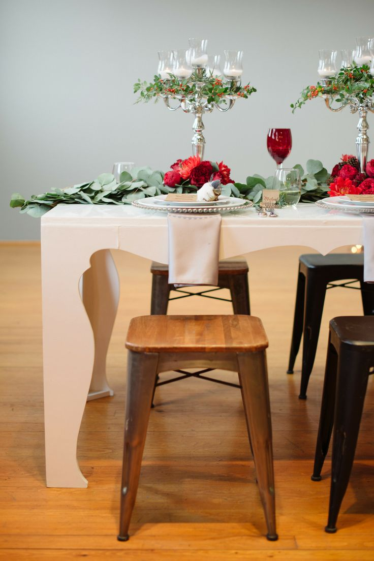 Bright red flowers, silver candelabra and candle - the perfect way to style a birthday celebration!