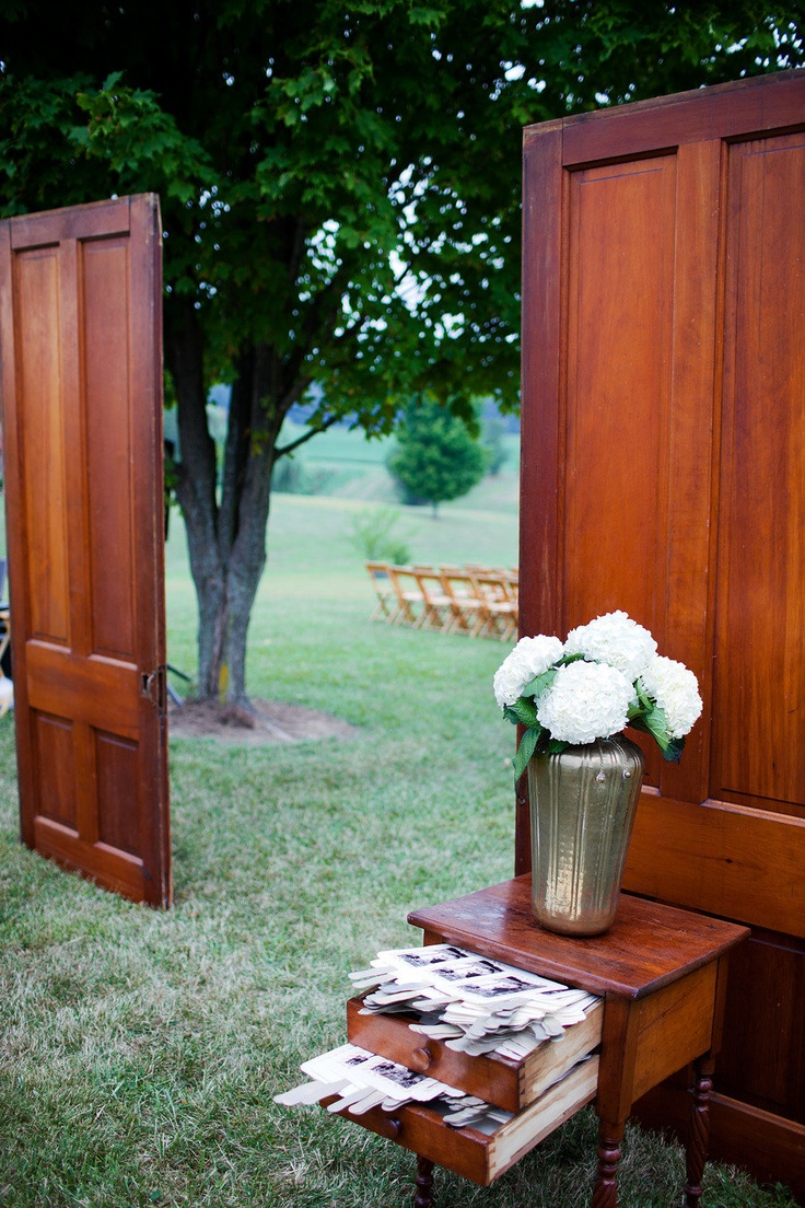 Frame the isle with old timber doors to add a unique touch to your ceremony.