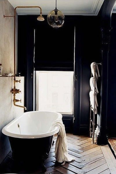 Love the herringbone timber floor, black stand alone bath tub, and copper feature pipe. Such a stunning bathroom full of texture and dark hues.