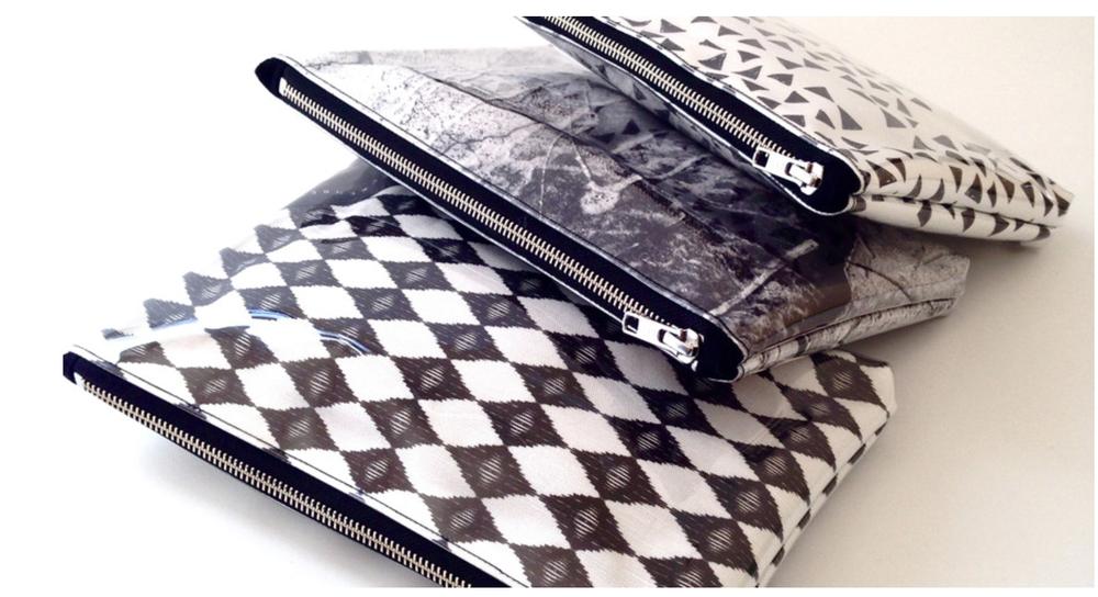 Black & White geometric printed clutch bags. Shop them  here!