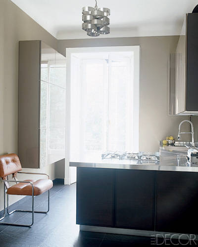 The paved slate tiles add a depth to the kitchen.