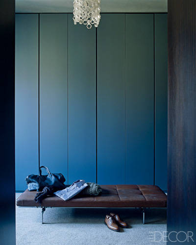 The dressing room features a daybed by Poul Kjaerholm