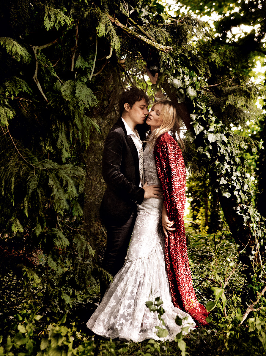 The newlyweds bring a bit of the Roaring '20s to the bucolic English countryside.  Rodarte paillette coat and beaded lace dress. Jamie wears Lanvin velvet blaze