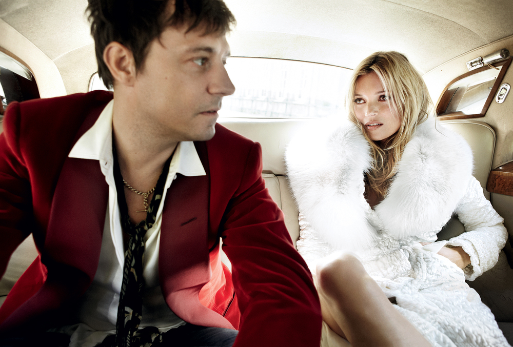 Jamie and Kate channel a modern-day Mick and Bianca Jagger, re-creating the couple's 1971 backseat wedding portrait by royal photographer Lord Lichfield. Tom Ford velvet-and-fur coat. On Hince: Tom Ford red velvet jacket.